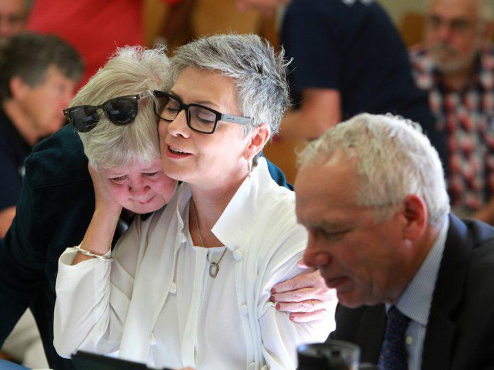 Rev. Gretta Vosper, centre, could be effectively fired from her job at West Hill United in Toronto following the results of a hearing later this fall. (Photo: Hugh Wesley)