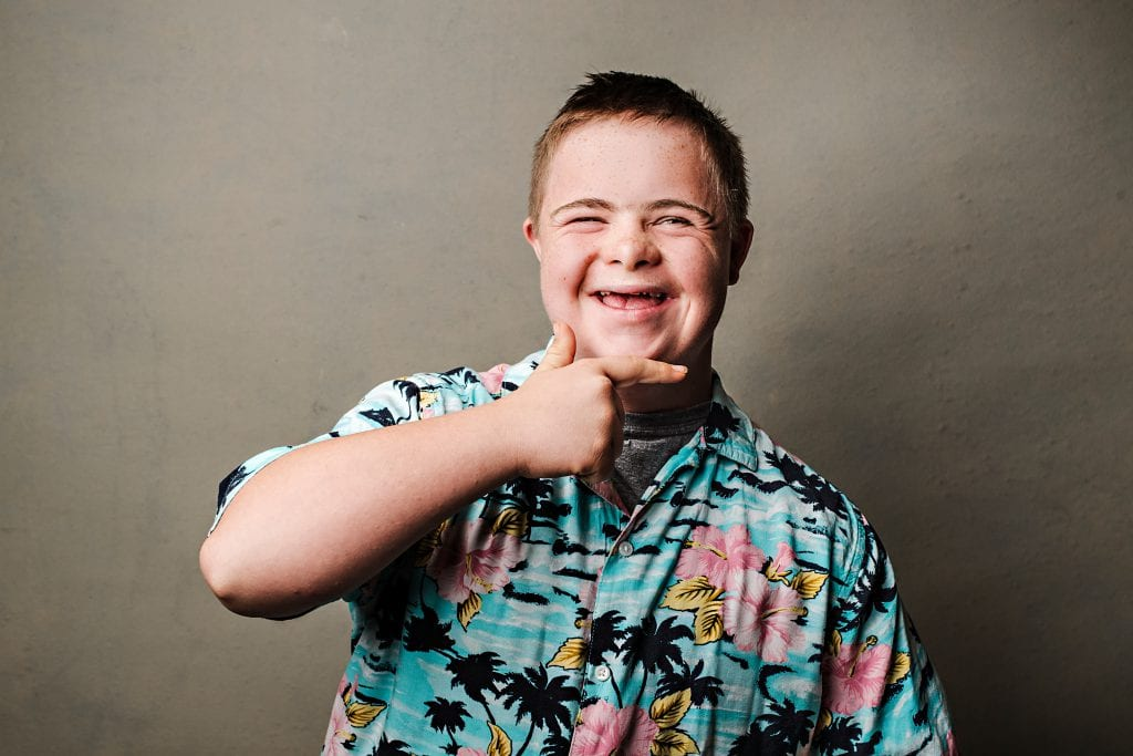 "Michael. Michael's family: ""I have a great life, but I am not a happy person 24 hours a day as many people think those with Down syndrome are. I have hopes and dreams just like everyone else and hope that one day, I will achieve them all!"" (Photo: Hilary Gauld Camilleri)"