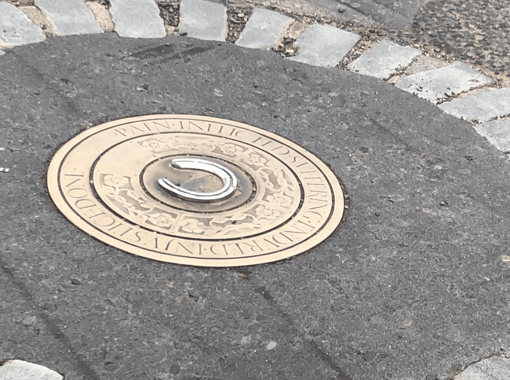 A plaque marks where the remains of seven so-called witches were buried. (Photo: Sarah Ratchford)