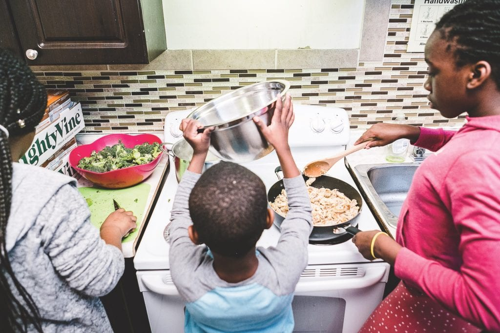 Life skills: Children gather at Believe to Achieve in northwest Toronto to provide a meal for those in need. At the same time, they learn cooking skills they can use in the future. (Photo: Bill Leontaritis)