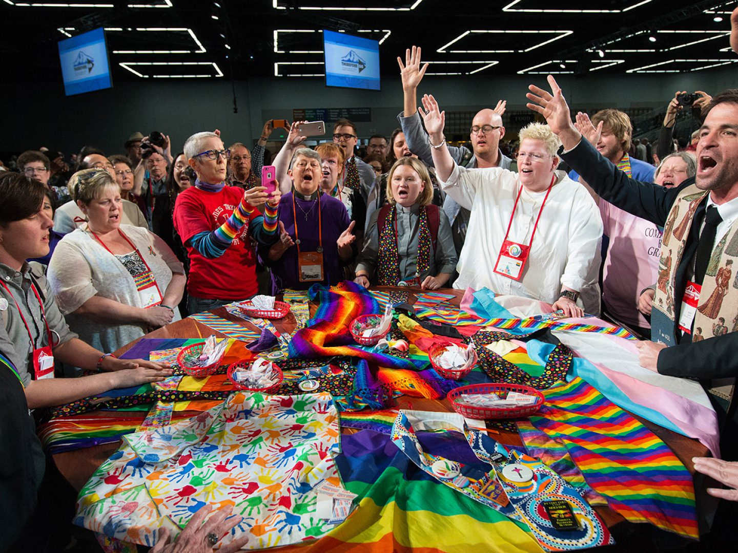 Supporters of LGBTQ rights in The United Methodist Church rally around the central Communion table at the close of the 2016 United Methodist General Conference in Portland, Ore. (Photo: Mike DuBose, courtesy of UMNS)